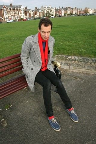 Matthew Pike - Topman Grey Double Breasted Long Coat, H&M Navy T Shirt, It Was A Present Bright Red Anchor Scarf, Cheap Monday Black Jeans, Topman Blue Canvas Boat Shoes, Red Socks - On The Sea Front