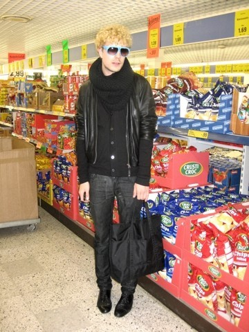 Vesa Perakyla - Thrifted Leather Lace Ups, Kokon Ta Zai Shades, H&M Wool Neck Warmer, Zara Leather Jacket, H&M Black Cardigan, Raf Simons Partially Latex Coated Jeans, Used To Be My Grand Ma's Black Tote - CRISPS