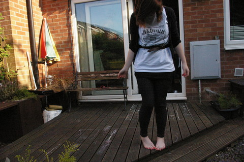Hannah L - Jack Daniels Tee, Long Vest, Jeggings, Leather Belt - Jack Daniels if you please