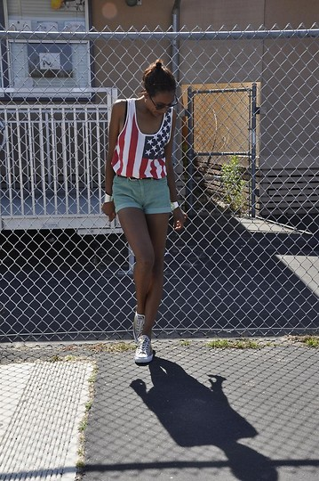 Michelle G. - Converse Chucks., Levi's® Shorts., Urban Outfitters Tanktop., Ray Ban Shades., Bracelets. - American Vintage.