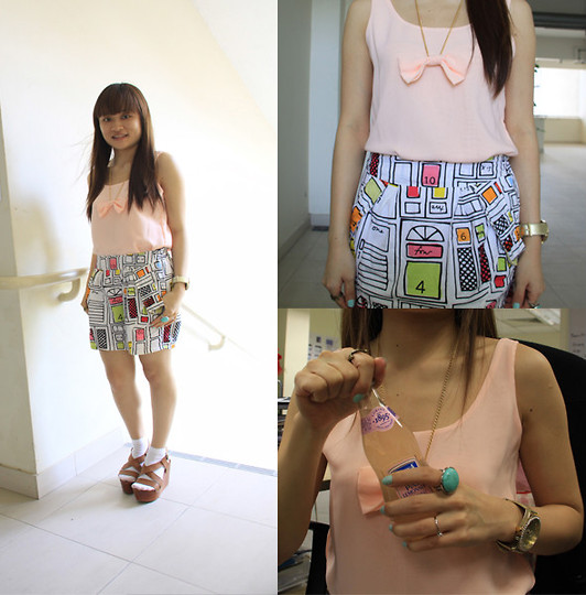 Ashley Liew - Peach Pink Sleeveless Top With Matching Bow Necklace, Bangkok, Thailand Graphic Tulip Skirt, French Connection Uk Gold Watch, Mango Turquoise Ring, Rusty Looking Crown Ring - Wind in my hair