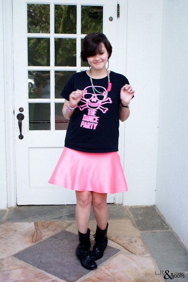 Gina S. - Concert Band T Shirt, Urban Outfitters Flower Chain Necklace, American Apparel Nylon Skirt, Combat Boots - Indie beat.