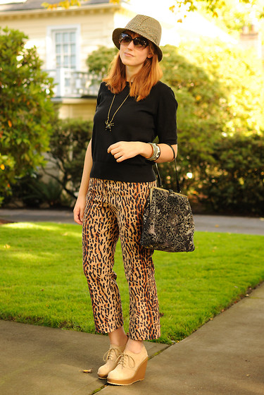 Stacey L - Black Sweater, Thrifted Leopard Print Pants, Urban Outfitters Beige Wedge Boots, Men's Hat - It's a jungle out there