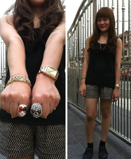 Ashley Liew - Vincci Black Leather Flats, Black Sleeveless Top With Matching Bow, Asos Gold Square Face Boyfriend Watch, Taipei, Taiwan Mixed Gold Bracelet, Face Mask Ring, Bling Skull Ring, Cotton On Patterned Shorts - Short and Sweet