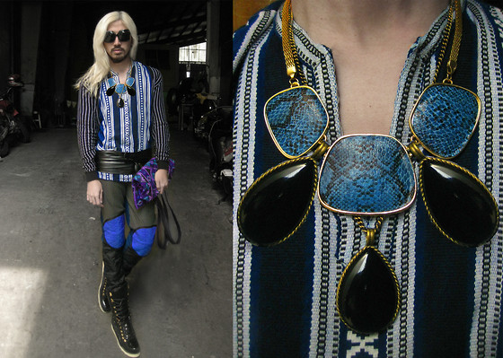 Andre Judd - Ethnic Patterned Bag, Blue Snakeskin And Black Resin Teardrop Pendants, Woven Ehtnic Top, Knitted Pinstriped Cardi, Leather Obi Belt Sash, Custodio Hybrid Biker Trousers In Three Kinds Of Fabric, Hybrid Patent Ski Boots - BIKER+ETHNIC