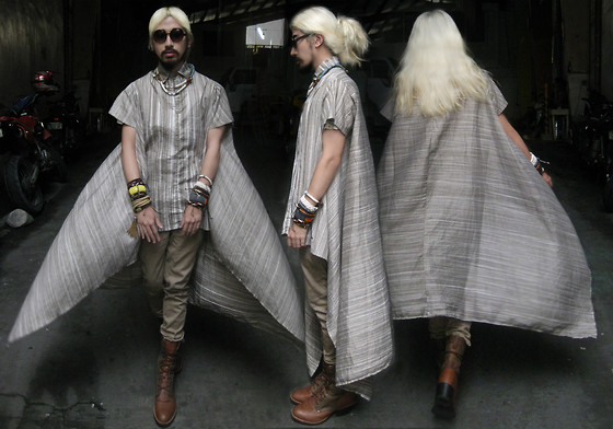 Andre Judd - Striped Linen/Cotton Weave Mullet Shirt With A Dramatic Train, Mixed Rope Bracelets, Braided Leather Cuffs, Rope Entwined Wood Bangles, Cotton Khaki Trousers, Leather Oxford/Hiking Boot Hybrid, Rope Necklaces - 6 FASHIONABLE DAYS TILL XMAS - PURIST CHIC