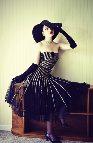 Ama Hatheway - Black And Gold Pumps, Antique Expo Vintage 1960s Black And Gold Dress, Mum Gold Belt, Black Sun Hat, Love Black Opera Gloves, Chanel Earrings, Girl I Used To Babysit Gave Me A Matching One   So Sweet Of Her! Gold And Rhinestone Necklace - Don't Look Down