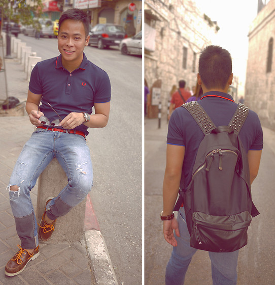 Dennis Robles - Givenchy Studded Backpack, Fred Perry Navy Pique Polo, Comme Des Garçons Red Belt, H&M Jeans, A.P.C. Brown Boat Shoes - Jerusalem israel look #366