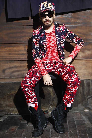 Andre Judd - Cherry Blossoms Print Jacket, Eairth Ikat Print Tee, Camo Print Trousers, Hawaiian Floral Baseball Cap, Red Socks, Dr. Martens Bondage Boots - CHERRY BOMB