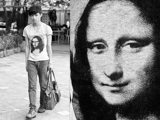 Brigiding Aricheta - V Neck Mona Lisa Printed Tee, Denim Jeans, Bradford Climbing Boots, Canvass And Leather Hand Bag - THEY HAVE NAMED YOU...