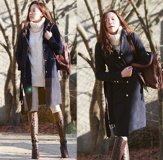 Becky Baek - Gold Belt Coat Navy, Fringe Backpack, Brown Lace Up Boots - Natural