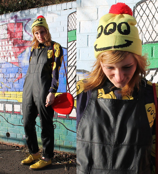 Sarah H. - Lazy Oaf Happy/Sad Beanie, H&M Leather Dungarees, Lazy Oaf Smiley Shirt, Dr. Martens Shoes, Topshop Heart Bag - CRAZY LAZY