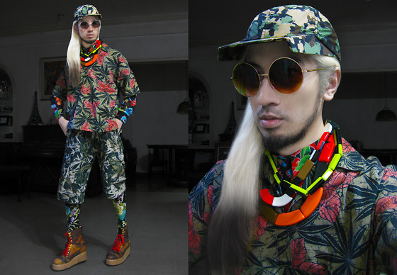 Andre Judd - Floral Camo Angular Visor Cap, Gold Round Frames, Marni Collection Of Neckpieces, African Print Pullover, Floral Print Button Down Shirt, Bamboo Print Boardies, Floral Print Leggings, Navajo Print Leather Flatform Booties - TROPICAMO