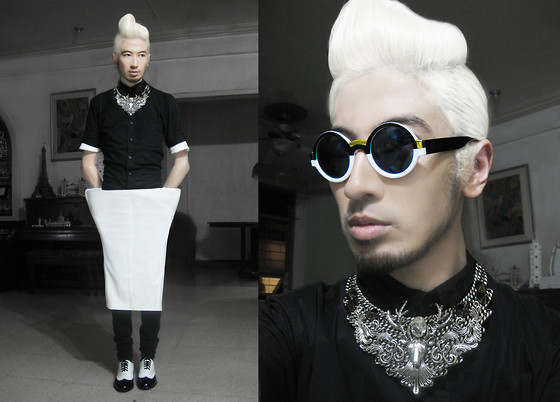 Andre Judd - Prettylittlefinds Two Tone Round Frames, Ken Samudio Threaded Chain With Deer And Barqoque Details, White Triangle Trousers, Two Tone Oxfords, Peaking White Tee Worn Under A Black Woven Polo Shirt - TWO TONED