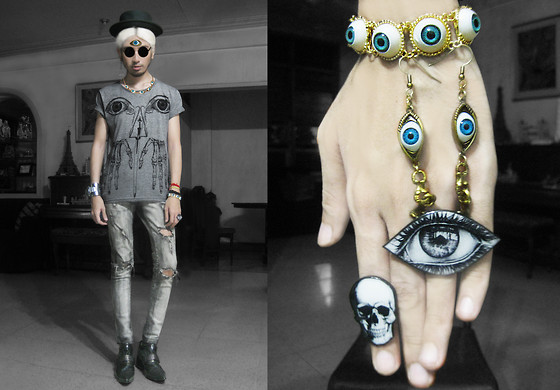 Andre Judd - Heather Grey Tee With Eye Print, Grey Wool Boater Hat, Maison Martin Margiela Casio G Shock By, House Of J Eyeball Bracelet, Antler Eyeball Earrings, Viva La Manika Eye Ring, Viva La Manila Skull Ring, Custom Made Destroyed Jeans, Pointed Grey Patent Rocker Booties, Eyeball Pendant Worn As 'Third Eye', Eyeball Necklace, Subcult Matte Black Skull Frames - THIRD EYE