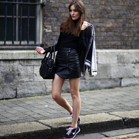 leather skirt and trainers