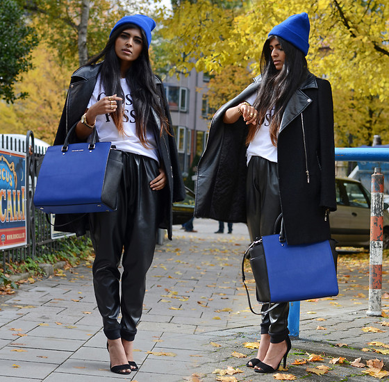 Kavita D - Ebay Blue Beanie, Sheinside Black Biker Coat, Brashy Couture Glossy Posse Tee, Michael Kors Watch, Michael Kors 'Selma Bag', Missguided Faux Leather Joggers, Ebay Strappy Heels - #HowIWearMyKors