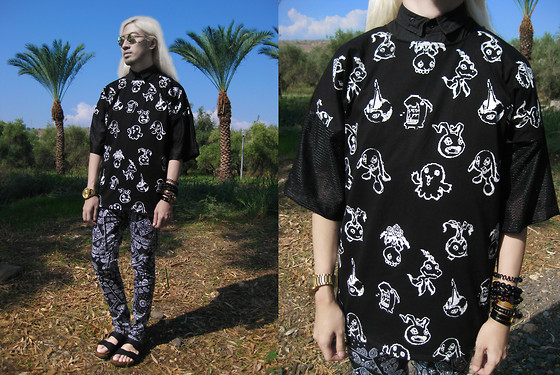 Andre Judd - Livestock Digimon Print Tee With Mesh Sleeves, Paisley Trousers, Birkenstock Sandals - DIGIMON DESERT
