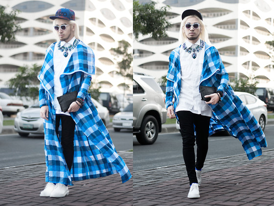 Andre Judd - Kenzo Dark Cloud Cap, Extremefinds Accessories Crystal Neckpiece, Renan Pacson Oversized Check Coat, Comme Des Garçons Embossed Clutch - CHECK IT OUT