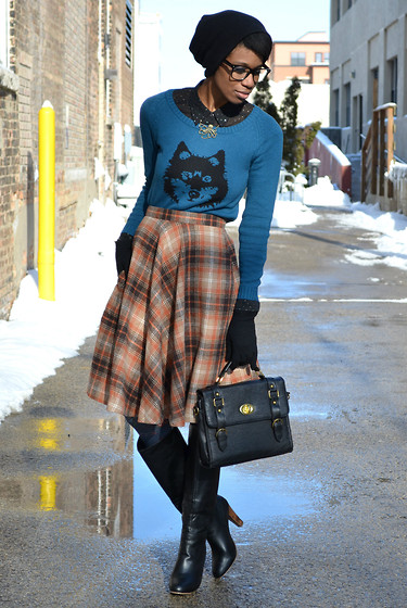 Sushanna M. - Bronze Octopus Pendant, Ladakh (Australia) Wolf Sweater, Pink Martini (Canada) Orange Plaid Skirt, Street Level Black Satchel, Black Pull On Wooden Heel Boots - Crepes & Coffee