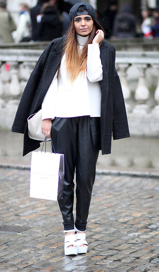 Kavita D - Boy London Cap, New Look Oversized Boyfriend Coat, Frontrowshop High Neck Scuba Top In White, Missguided Faux Leather Joggers, River Island Cleated Sole White Heels - London Fashion Week Day One 2014