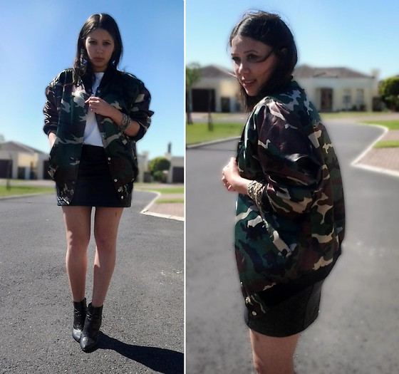 Tneale Williams - Vintage Camouflage Bomber Jacket, White Crew Neck, Leather Skirt - Chaos Keeps Me Grounded.