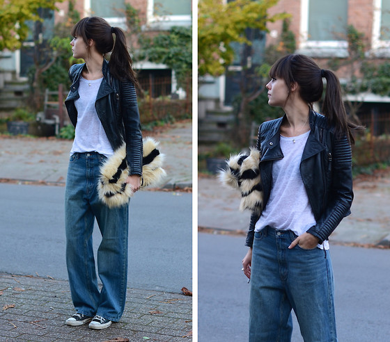 Lucy De B. - Oversized Jeans, Big Furry Clutch - The bigger, the better.