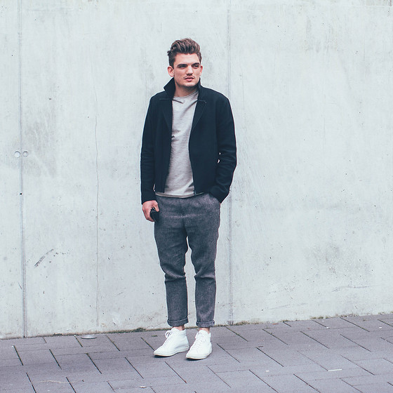 Florian Roser - Cos Jacket, Cos T Shirt, Asos Pants, Common Projects Sneakers - Concrete wall