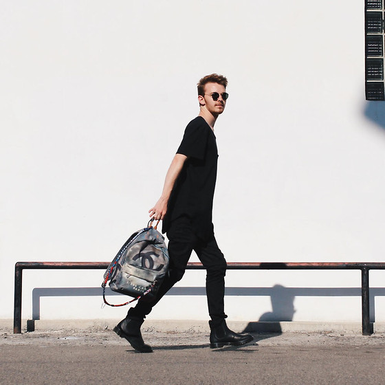 Drew Scott - Feathers Black Long Tee, Urban Outfitters Paneled Denim, Dr. Martens Chelsea Boots, Chanel Grafitti Bag, Ray Ban Round Vintage Sunnies - Don't give it up