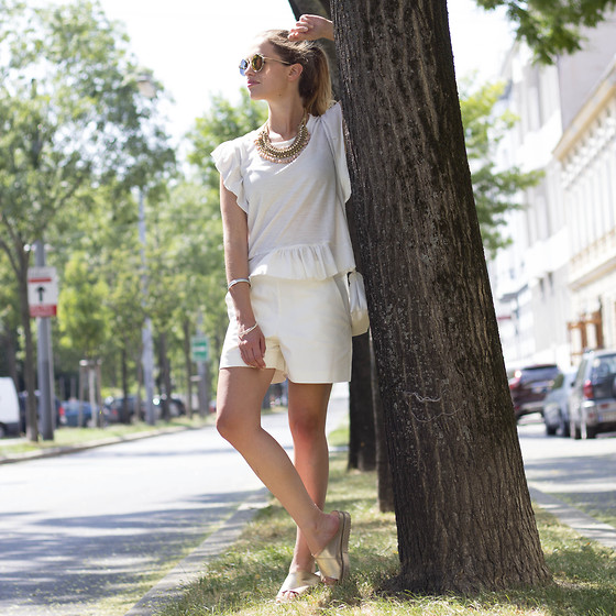 Ina Nuvo - Mango Ruffled White Blouse, Hallhuber Straight Cut Shorts, Buffalo Shoes Golden Sandals, Le Specs Wild Child Sunnies, Unknown Pebbled Necklace - All White