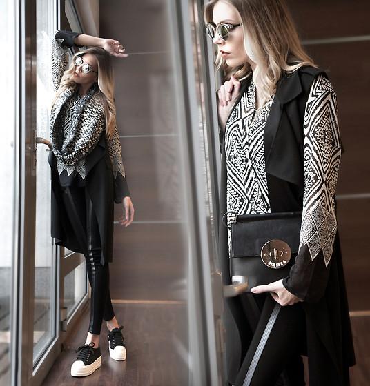 Dora D. - Black Sleeveless Long Coat, Redial Black Leather Applique Leggings, Black And White Silk Blouse, Pabia Bag - Behind the window