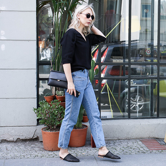 Leonie // www.noanoir.com - Ace & Tate Black Round Sunglasses, & Other Stories Black Deep V Neck Blouse, Closed High Waisted Vintage Denim Jeans, & Other Stories Black Braided Leather Slip In Mules, Eleven Black Leather Mini Bag - Pedal Pusher