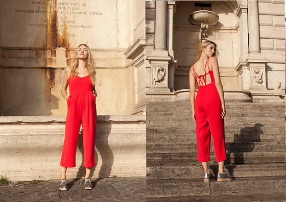 Eleonora Albrecht - T&C.G Solid Color Spaghetti Straps Jumpsuit, Soldini Glittered Shoes - The woman in the red jumpsuit