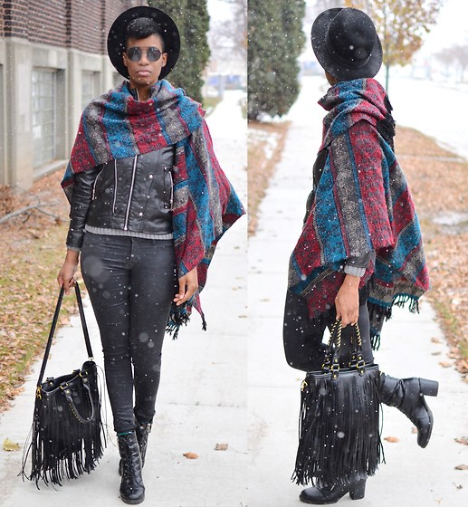 Sushanna M. - Zerouv Black Browline Flip Sunglasses, Vintage Patterned Fringed Poncho, Black Faux Leather Jacket, Black Wax Skinny Jeans, Black Buckled Zippered Ankle Boots - Wax Poetic