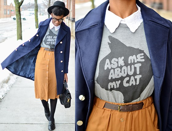 Sushanna M. - Thrifted Black Fedora, Fashion Mia Navy Double Breasted Duster Coat, Tan High Waisted Skirt, Thrifted Vintage Men's Black Wingtip Tassel Loafers - Blue Calico