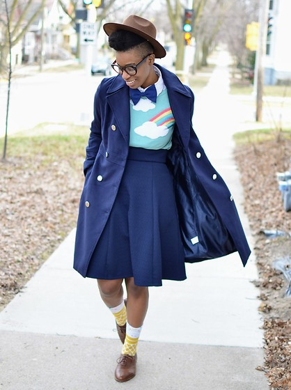 Sushanna M. - Thrifted Brown Hat, Navy Double Breasted Coat, Thrifted Vintage Navy Bow Tie, Rainbow Sweater, High Waisted Navy Skirt, Thrifted Vintage Men's Brown Wingtip Oxfords - The Sky's The Limit
