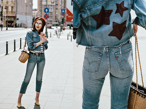 Andreea Birsan - Relaxed Light Wash Raw Hem Jeans, Star Printed Denim Jacket, Striped Shirt, Leather Belt, Beige Suede Heeled Mules, Raffia Bag, Mirrored Sunglasses - Double denim