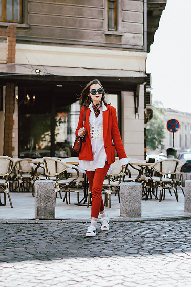 Andreea Birsan - Red Blazer, Oversize White Button Down Shirt, White Lace Up Corset, Red Trousers, Ace Print White Sneakers - Suit up