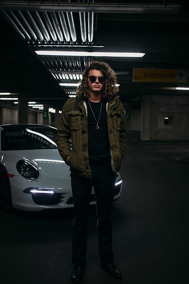Caleb Paulson - Hugo Boss Black Slacks, Steve Madden Black Boots, Apt 9 Black Shirt, American Eagle Outfitters Green Army Jacket, Freyrs Black Sunglasses, Asos Gold Necklace - Porsche