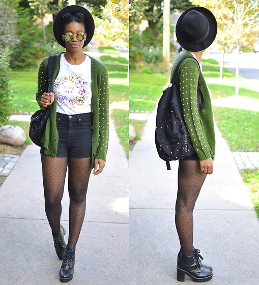 Sushanna M. - Thrifted Black Fedora, Studded Green Cardigan, White Floral Tee, High Waisted Black Shorts, Sheer Diamond Pattern Tights, Thrifted Black Platform Boots, Black Studded Backpack - Take A Picture, It'll Last Longer