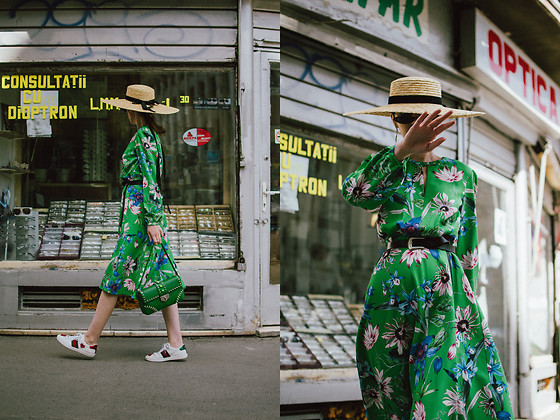Andreea Birsan - Green Midi Floral Dress, Straw Hat, Leather Belt, Ace Heart Embroidered Sneakers, Green Shoulder Bag With Studs And Stones, Small Cat Eye Sunglasses - Floral dress & sneakers