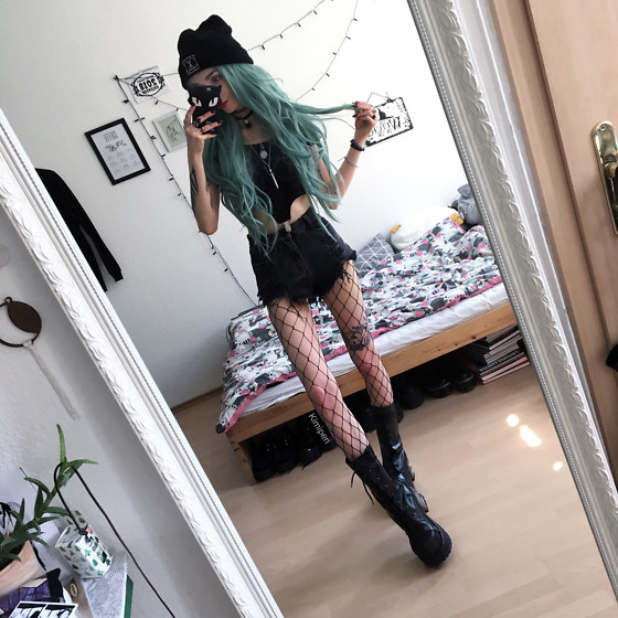 Kimi Peri - Fishnet Tights, Vork Vegan Boots, Vii & Co. Denim Shorts, Long Clothing Logo Beanie, Sword Necklace, Solrayz Moonstone Necklace, Shop Chokers No Face Choker, Vii & Co. Velvet Suspender Top - Goth Mermaid