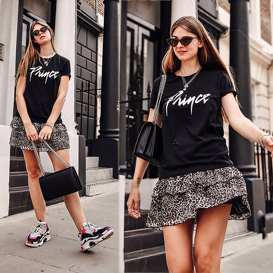 Jacky - Balenciaga Sneakers - Combining a leo print skirt with a band shirt
