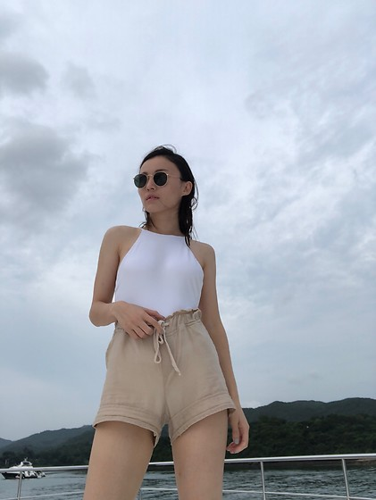 Kay Lai - Her The Label Swim Suit, Ray Ban Sunnies - White sky