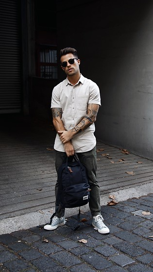Kevin Elezaj - Converse Sneakers, Scotch & Soda Chino, Topman Shirt, Ray Ban Glasses, Eastpak Bag - Tones