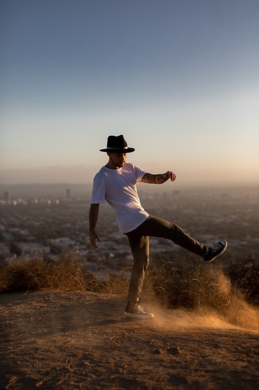 Kevin Elezaj - Converse Sneakers, Scotch & Soda Pants, Cos T Shirt, Brixton Hat - Runyon