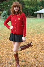Erica T. - English Jacket, Pleated Skirt, Brown Boots, Gold Socks - Red Morning Light