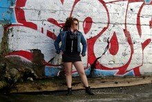 Emmy N - American Apparel Medusa Hoodie, H&M Jean Jacket, Vintage Leopard Scarf, H&M Leopard Denim Skirt, Urban Planet Peter Pan Boots - Gang signs on the beach.