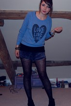 Jessica Searle - Patterned Black Tights, Studded Black Ankle Boots, Love Blue Sweater, Dorothy Perkins Black V Neck Vest Top, Urban Outfitters Shiny Studded Bangle, H&M Gold Charm Bracelet, Urban Outfitters Rope And Chain Bracelet, American Apparel Denim Acid Wash Short - This is how we do it