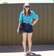 Maddison K - Groove Round Black Sunglasses, Norwiss Blue Blouse, Diva Silver Locket, Now Dark Blue High Waisted Denim Shorts, Sportsgirl Black Handbag, Free People Silver Sandals - He's a guy that you should feel sorry for